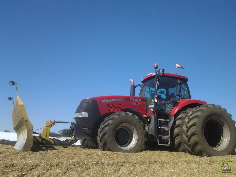 Case Magnum 335 tractor with front mounted silage blade