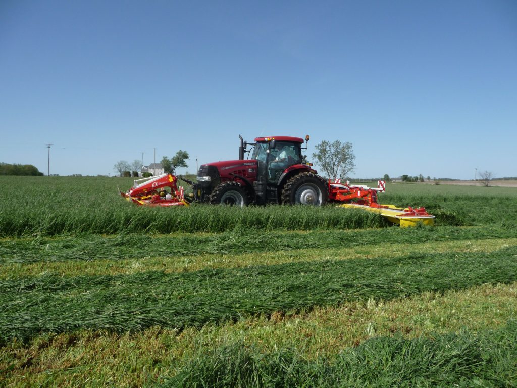 Case Puma 210 tractor with front mounted mower