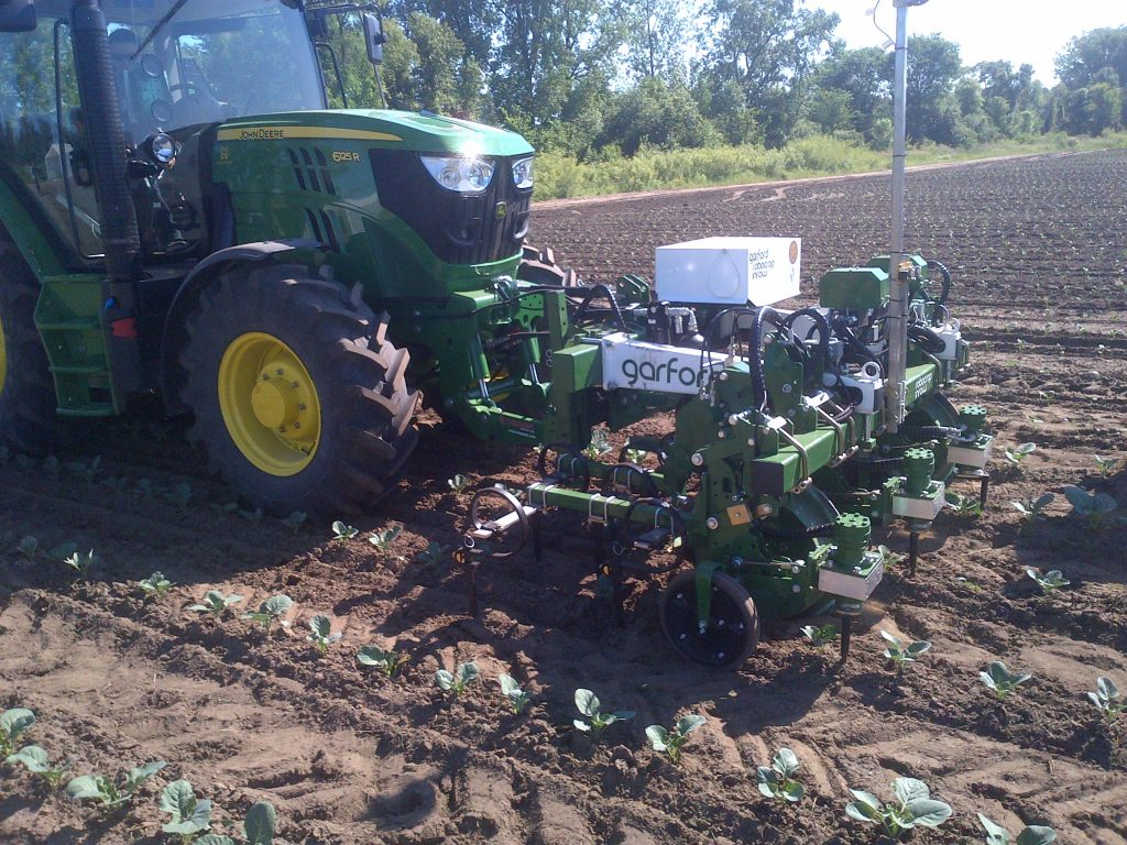John Deere 6125R tractor with front mounted planter