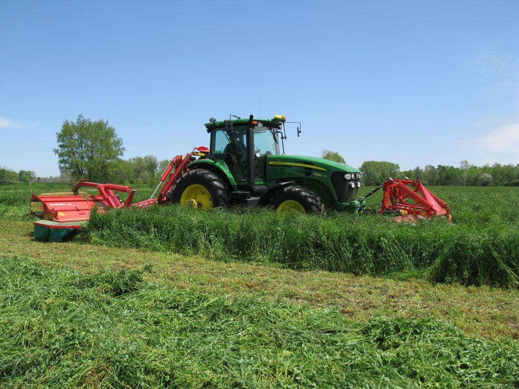 John Deere 7930 tractor with front mounted mower