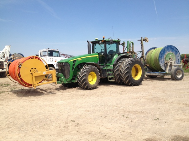 John Deere 8530 tractor with front mounted manure reel