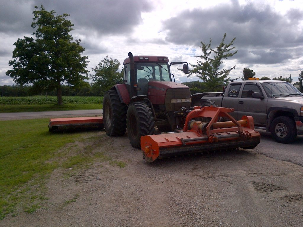 Zuidberg front 3pt hitch and PTO on a Case MX135 with a front mounted flail mower