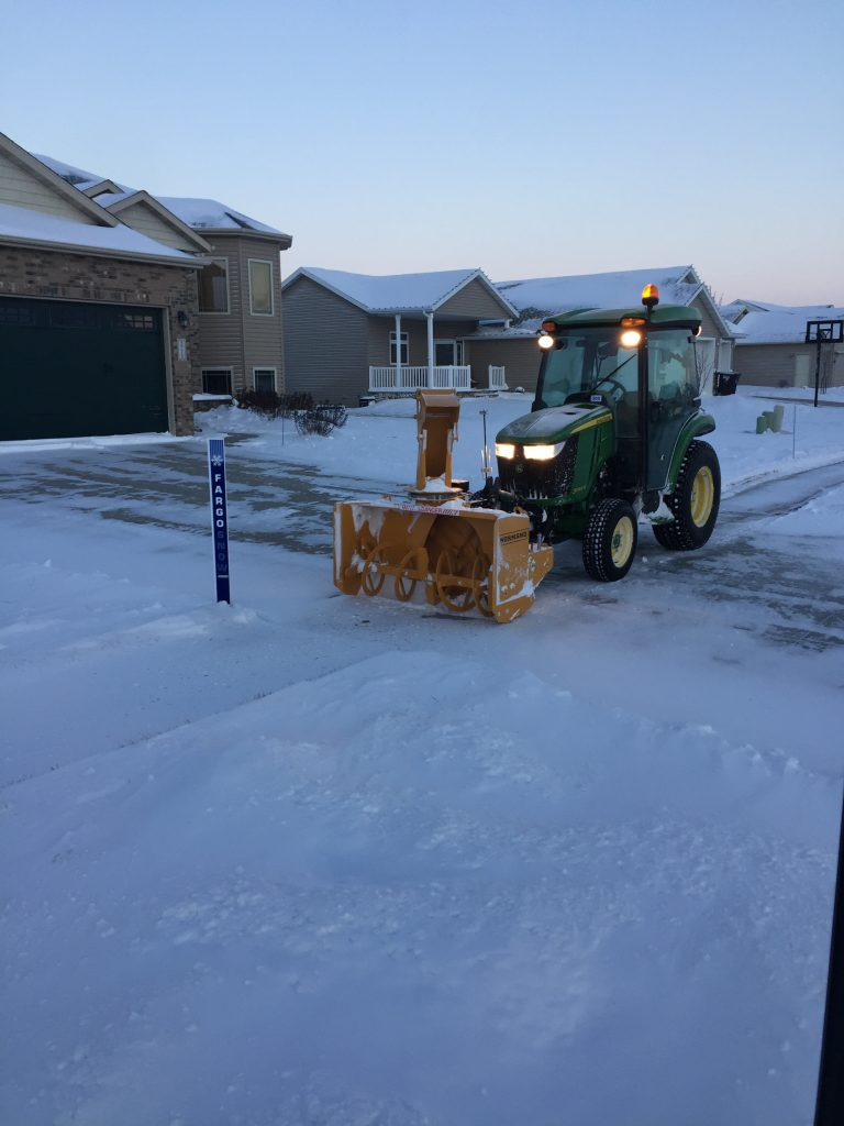 Zuidberg front 3pt hitch and PTO on a John Deere 3046R with front mounted snow blower