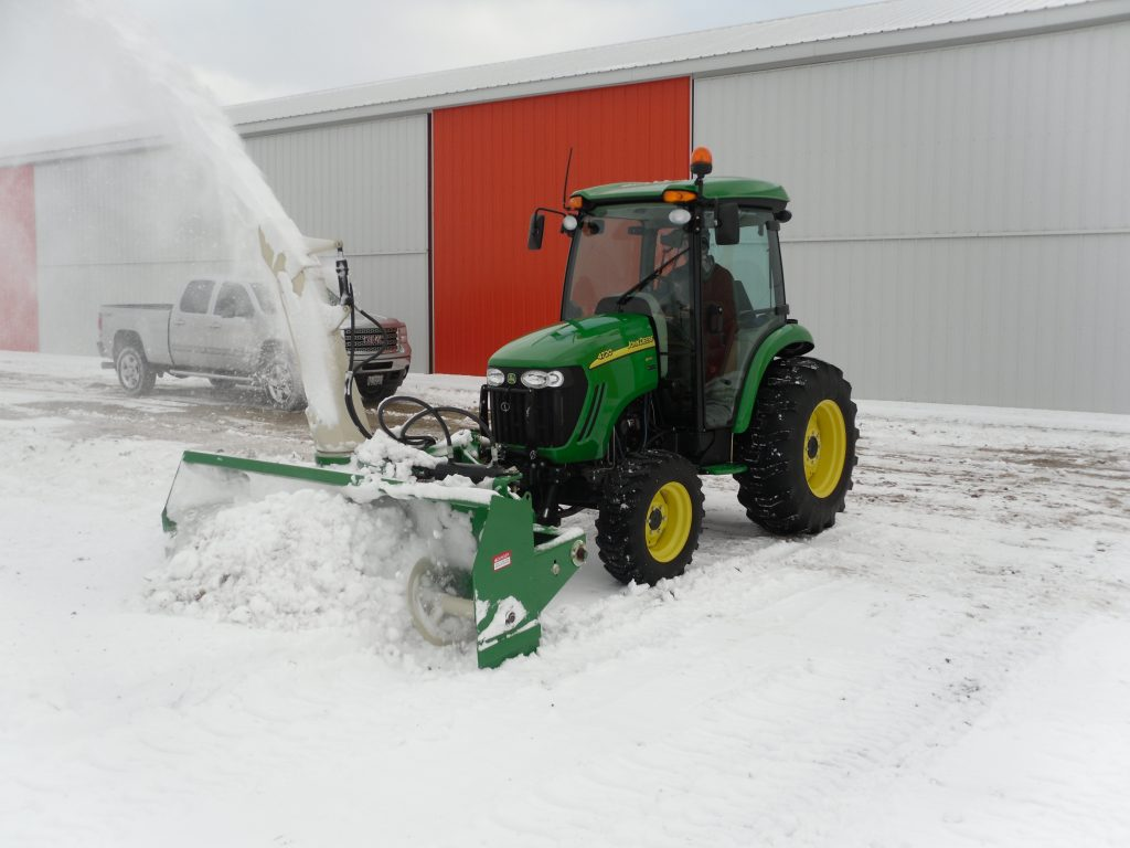 Zuidberg front 3pt hitch and PTO on a John Deere 4720 with a front mounted snow blower