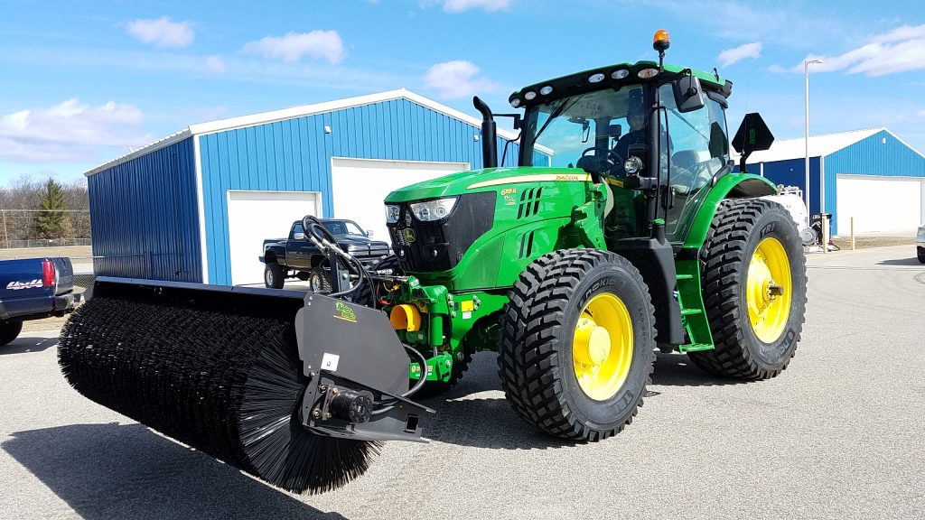 Zuidberg front 3pt hitch and PTO on a John Deere 6155R with a front mounted broom