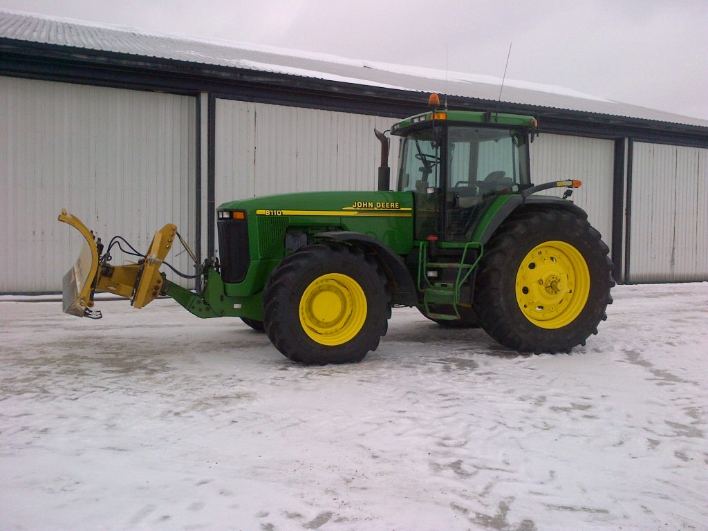 Zuidberg front 3pt hitch on a John Deere 8110 with a front mounted snow blade